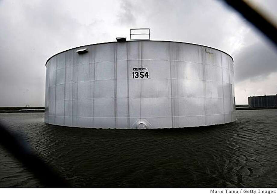 A crude oil storage tank is surrounded by floodwaters from Hurricane Gustav September 2, 2008 in Chauvin, Louisiana. Chauvin is located just north of Cocodrie, where Hurricane Gustav made landfall. A significant amount of U.S. oil production comes from Louisiana and was threatened by the storm. Photo: Getty Images