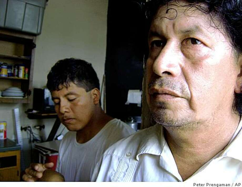 Jose Gordillo, right, and his son Raul Hernandez, both natives of Mexico, are seen at  home where they live in New Orleans, Tuesday, Sept. 2, 2008. The two are illegal immigrants who have been helping rebuilding New Orleans since Hurricane Katrina. They stayed behind when Gustav struck because they were afraid of being arrested if they boarded the buses and trains arranged by emergency officials. (AP Photo/Peter Prengaman) Photo: Peter Prengaman, AP