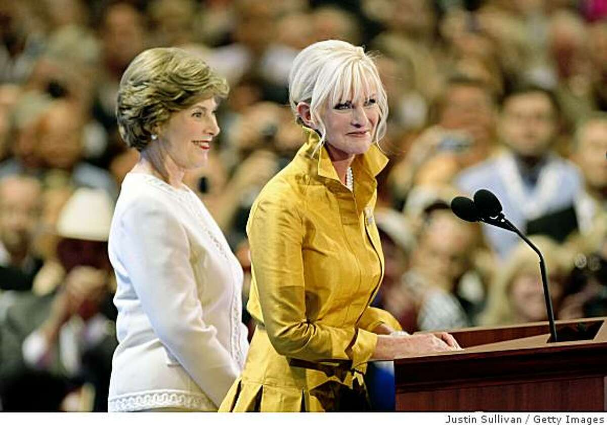 ST. PAUL, MN - SEPTEMBER 01: Cindy McCain (R), wife of presumptive Republican presidential nominee U.S. Sen. John McCain (R-AZ), speaks as on day one of the Republican National Convention (RNC) at the Xcefirst lady Laura Bush listens Energy Center September 1, 2008 in St. Paul, Minnesota. The GOP will nominate U.S. Sen. John McCain (R-AZ) as the Republican choice for U.S. President on the last day of the convention. (Photo by Justin Sullivan/Getty Images)