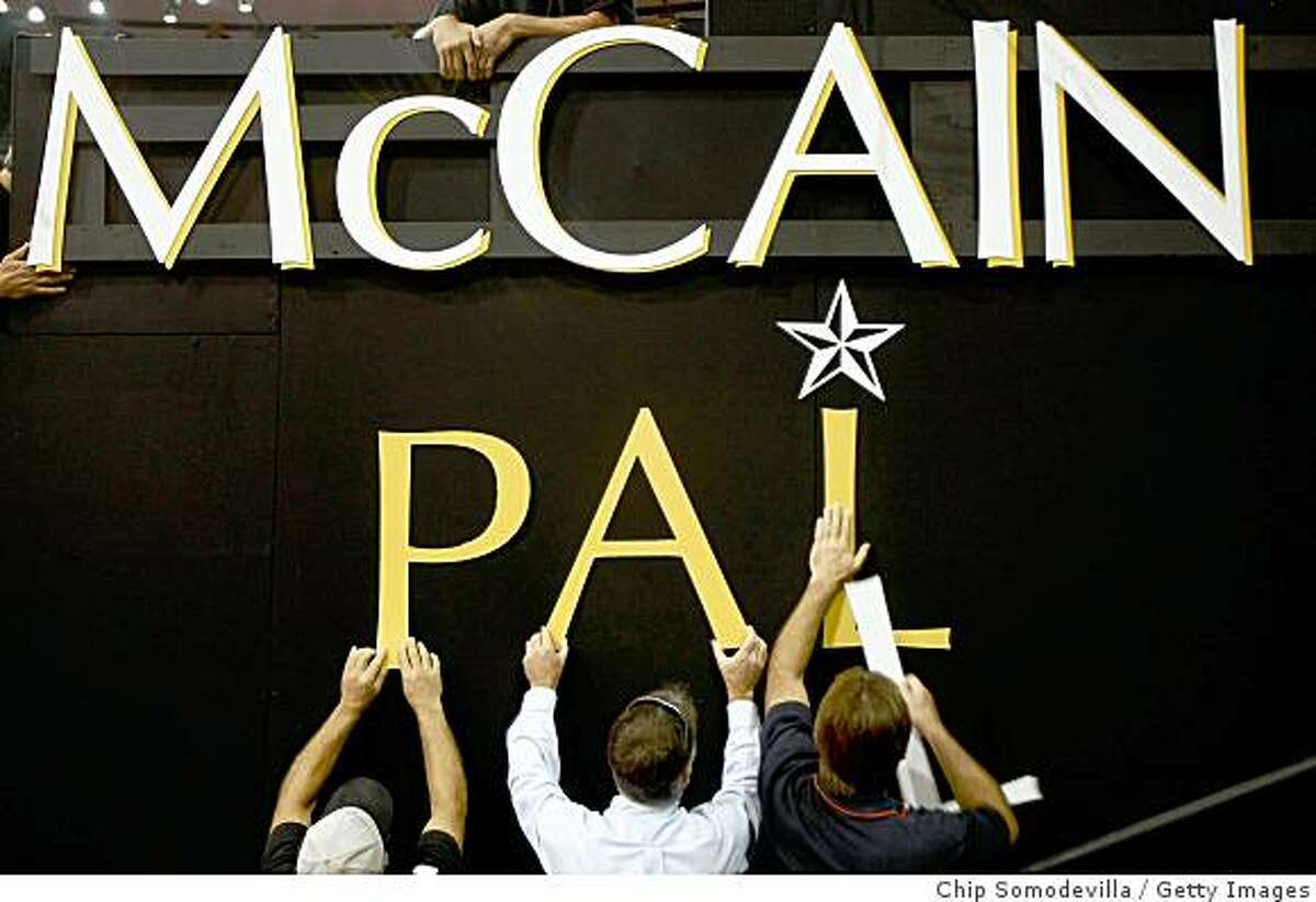ST. PAUL, MN - SEPTEMBER 01: Workers hang letters spelling out McCain and Palin on day one of the Republican National Convention (RNC) at the Xcel Energy Center on September 1, 2008 in St. Paul, Minnesota. The GOP will nominate U.S. Sen. John McCain (R-AZ) as the Republican choice for U.S. President on the last day of the convention. (Photo by Chip Somodevilla/Getty Images)