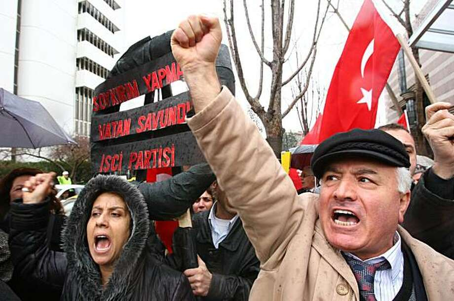 "Protesters, holding Turkish flags, shout slogans during a demonstration in front of the U.S. Embassy in Ankara March 5, 2010.  Turkey today slammed furiously a US Congress panel's resolution calling the Ottoman-era massacre of Armenians ""genocide"", warning of damage to bilateral ties and peace efforts with Armenia. Having recalled its ambassador immediately after the resolution was adopted, Ankara warned that Washington risked a showdown with a key Muslim ally if the resolution advanced to a full vote atthe House of Representatives. Photo: Adem Altan, AFP/Getty Images"