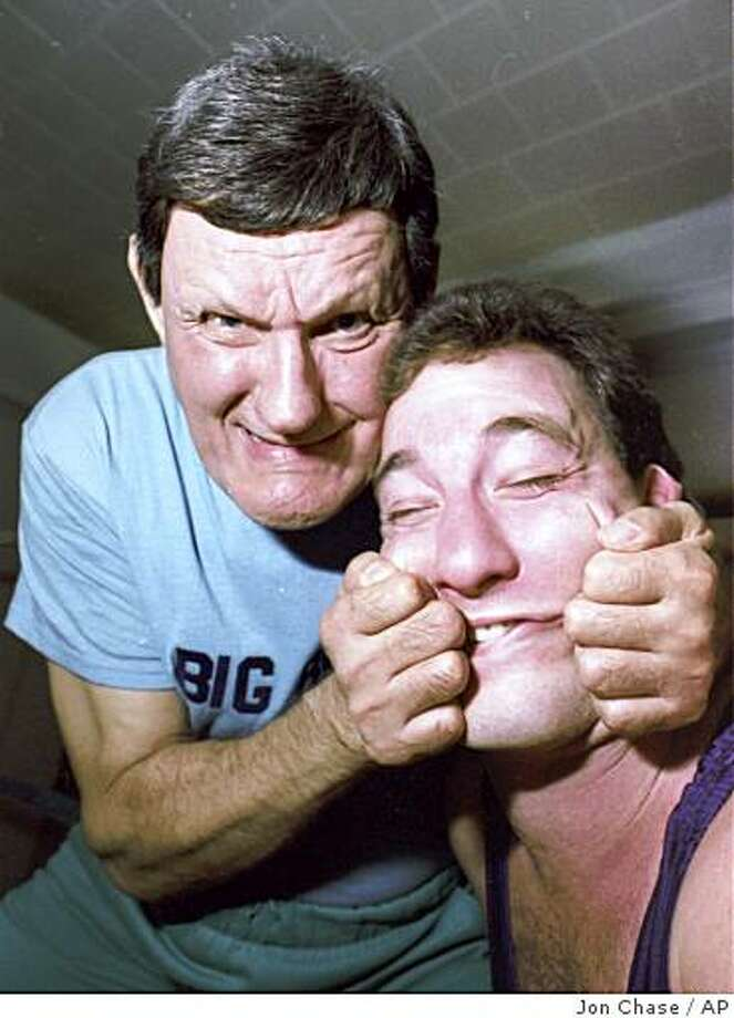 "** FILE ** In this 1989 file photo, professional wrestler Walter ""Killer"" Kowalski, left, demonstrates a ""claw"" hold on the face of his nephew Mitch, during an interview about teaching wrestling techniques. Kowalski, 81, died Saturday, Aug. 30, 2008, from a heart attack. (AP Photo/Jon Chase, File) Photo: Jon Chase, AP"