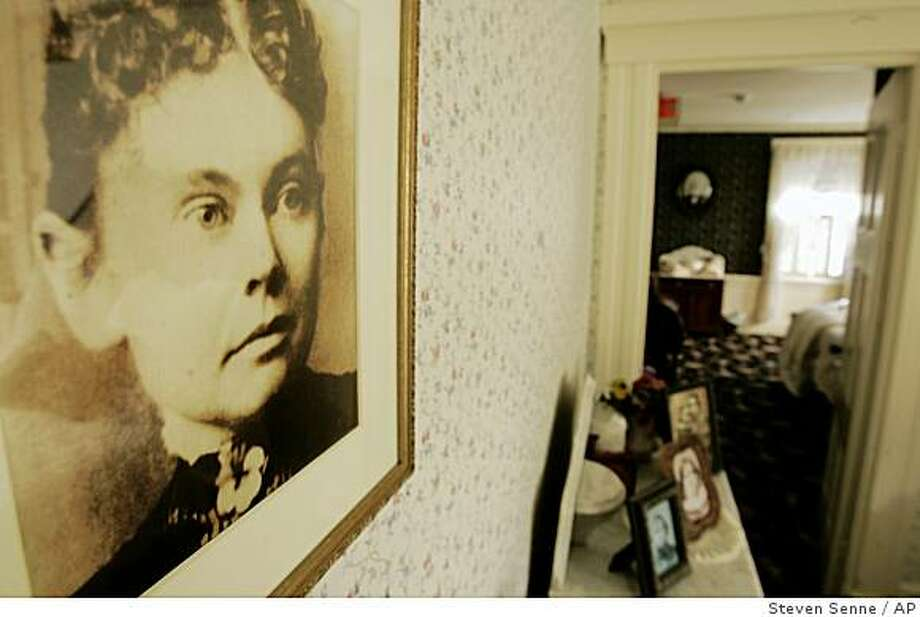 A photograph of Lizzie Borden appears in the Lizzie Borden Bed and Breakfast, in Fall River, Mass., Wednesday, Aug. 20, 2008.  The owner of the site of the 1892 double murder has filed a federal lawsuit to prevent a new museum and shop in Salem from using the name of the infamous former Sunday school teacher who was accused in the hatchet deaths of her wealthy father and stepmother. (AP Photo/Steven Senne) Photo: Steven Senne, AP