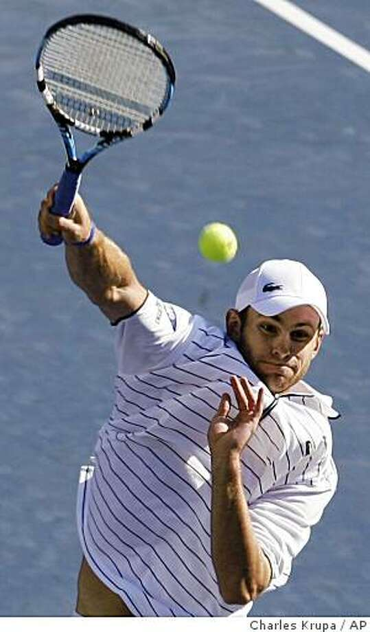 Andy Roddick, of the United States, serves to Andreas Seppi, of Italy, during a match at the U.S. Open tennis tournament in New York, Sunday, Aug. 31, 2008. (AP Photo/Charles Krupa) Photo: Charles Krupa, AP