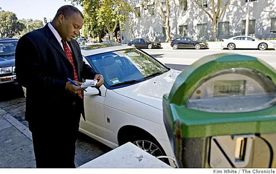 Nathaniel Ford, executive director of the Municipal Transportation Agency, wirtes out a parking citation in San Francisco, Calif., on Wednesday, August 27, 2008. Photo: Kim White, The Chronicle