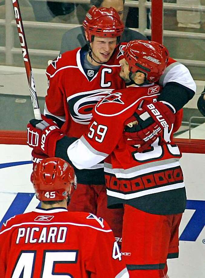 Carolina Hurricanes' Eric Staal, top left, congratulates Chad LaRose (59) on his goal with Alexandre Picard (45) nearby, during the second period of an NHL hockey game against the Ottawa Senators in Raleigh, N.C., Thursday, March 4, 2010. Hurricanes won 4-1. Photo: Karl B DeBlaker, AP