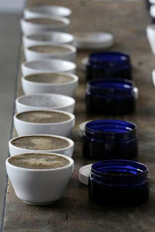 Coffee cups and bean samples are lined up for a cupping on the production floor at Ritual Coffee Roasters on Thursday, March 4, 2010. Photo: Lea Suzuki, . The Chronicle