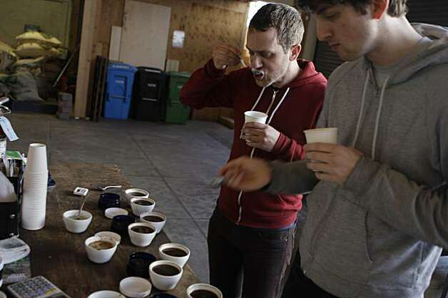 Ryan Brown, Ritual Coffee Roasters buyer ( l to r) and Ben Kaminsky, quality control  Ritual Coffee Roasters,  taste coffee during a cupping at  Ritual Coffee Roasters on Thursday, March 4, 2010.  Cupping is a quality control measure. Photo: Lea Suzuki, The Chronicle