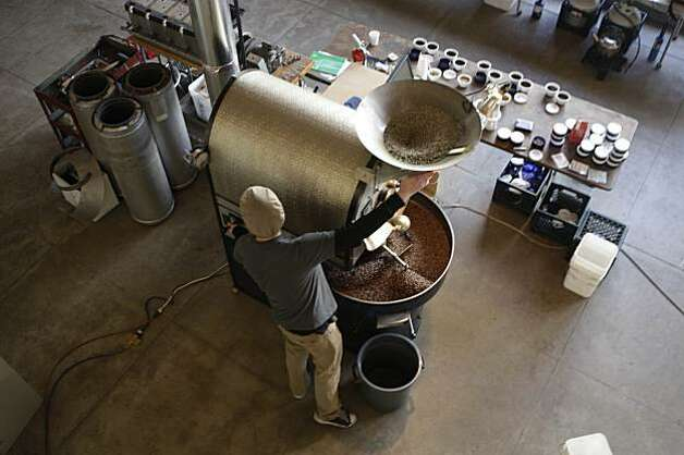 Joel Edwards, Ritual Coffee Roasters production roaster, works the roaster at Ritual Coffee Roasters. Photo: Lea Suzuki, The Chronicle