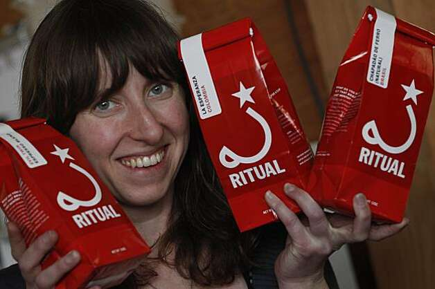 Eileen Hassi, owner Ritual Coffee Roasters, poses with bags of Ritual Coffee Roasters coffee. Photo: Lea Suzuki, The Chronicle