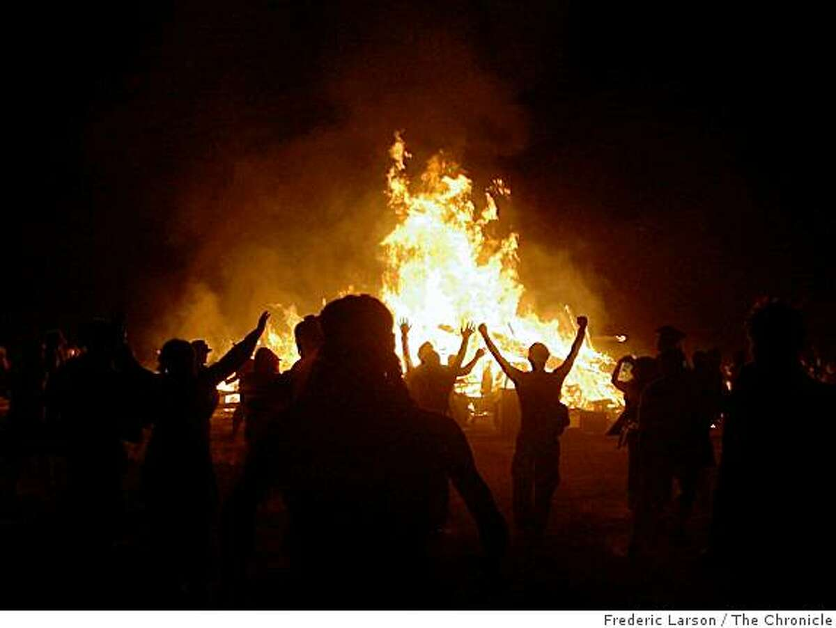 """Thousands of """"burners"""" rushed to the flames at the Burning Man festival when the ceremony escalated to a fever pitch at Black Rock NV, on August 30, 2008."""