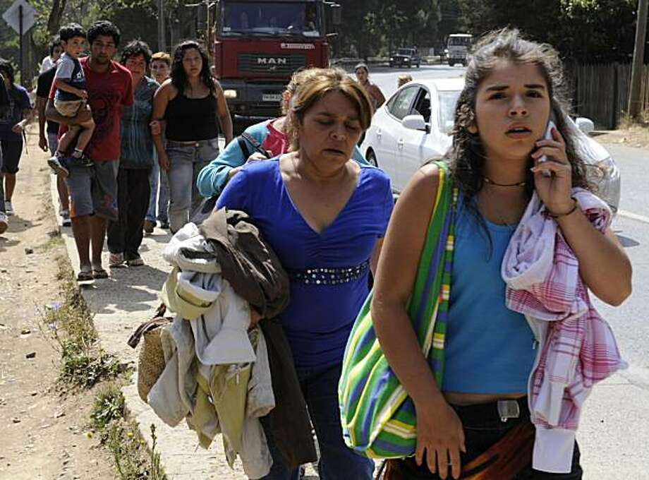 Local residents walk in a street after a rumour of another tsunami spreads in Constitucion, some 300 km south of Santiago, March 3, 2010. The official death toll from Saturday's 8.8-magnitude earthquake in Chile and the tsunami it unleashed rose from 795to 799 Wednesday, the national emergency office said. Among the confirmed deaths were 587 in the Maule region, south of Santiago; 92 killed in Bio Bio; 48 in O'Higgins; 38 in the capital's metropolitan area; 20 in Valparaiso and 14 in Araucania, the office said. Photo: Daniel Caselli, AFP/Getty Images