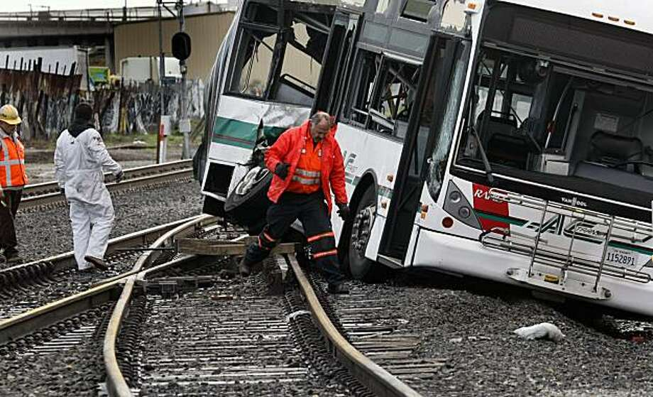 Emergency crews check out the front half of a AC Transit bus that was hit by a Amtrak train as it crossed 66th avenue in Oakland Wednesday March. 3, 2010 and cut in half. Officials are thankful that the bus was empty at the time of the accident and the driver wasnÕt injured in the 6:30am incident. Photo: Lance Iversen, The Chronicle