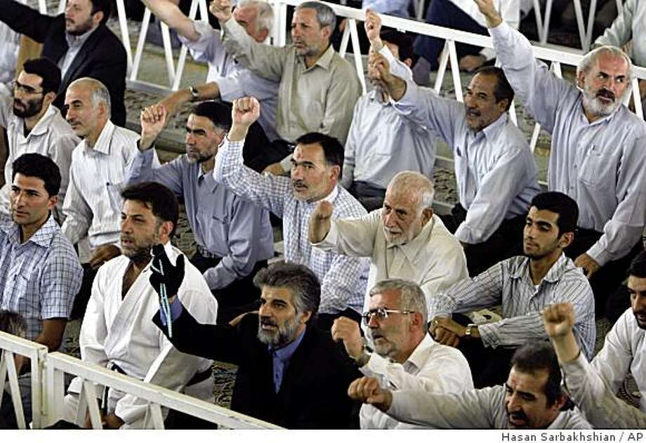 "** ADVANCE FOR SUNDAY, AUG. 31 ** Iranians chant ""death to America"" as they attend a prayer ceremony in Tehran on Friday Aug. 8, 2008. (AP photo/Hasan Sarbakhshian) Photo: Hasan Sarbakhshian, AP"
