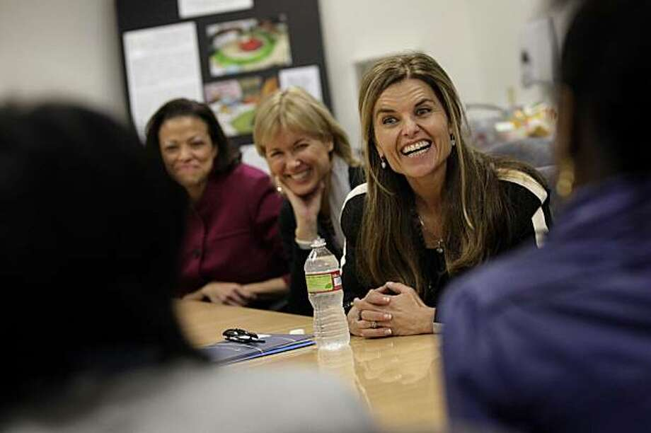 Nicole Taylor (l to r) President and CEO East Bay Community Foundation; Sandy Gleysteen, Executive Producer of Women's Conference and helps to run the Minerva program and First Lady Maria Shriver share a laugh with two girls who talk about their experiences making Minerva Quilts while incarcerated at the Alameda County Juvenile Justice Center in San Leandro, Calif. on Wednesday, March 3, 2010. Photo: Lea Suzuki, The Chronicle
