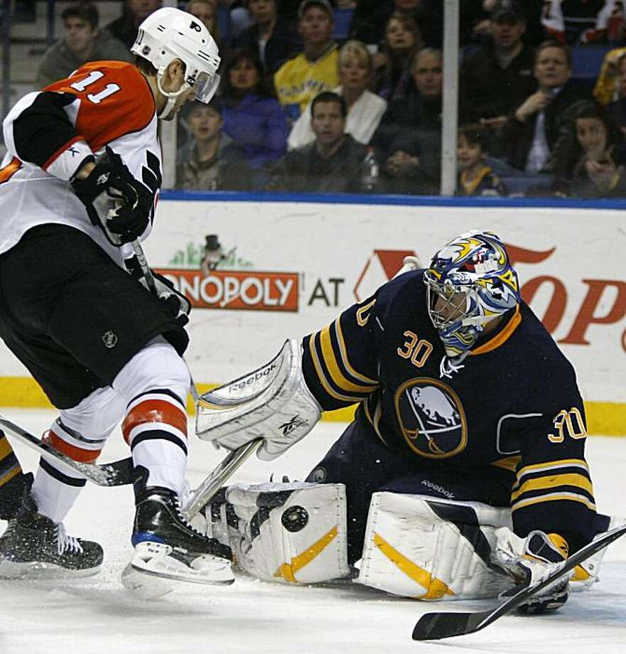 Buffalo Sabres goalie Ryan Miller makes a save on a shot by Philadelphia Flyers' Blair Betts (11) during the second period of the NHL hockey game in Buffalo, N.Y., Friday, March 5, 2010. Photo: David Duprey, AP