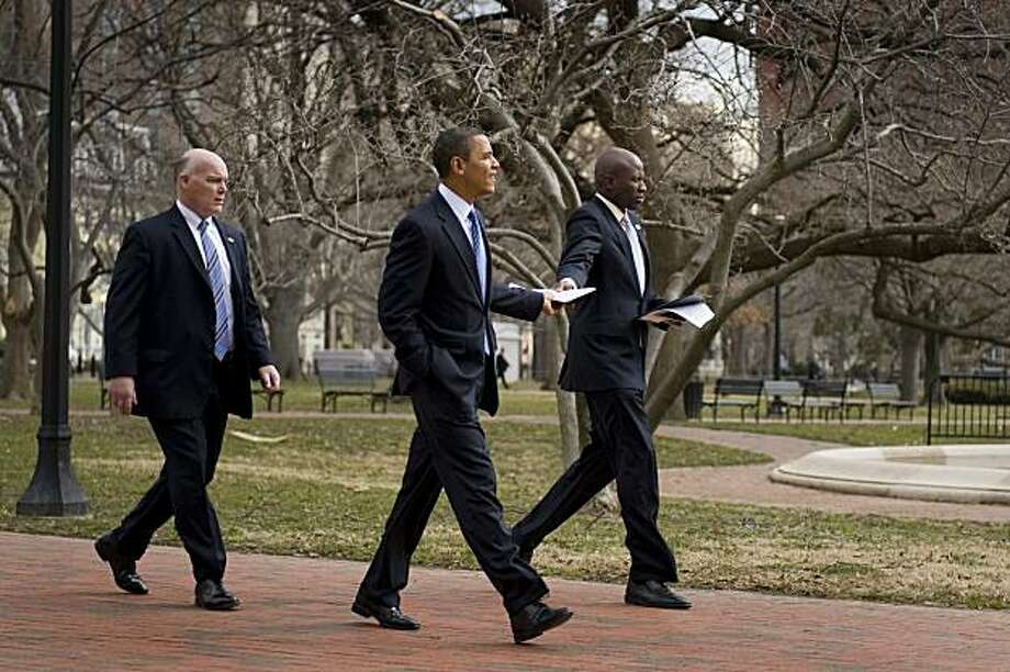 US President Barack Obama (C) walks through Lafayette Park to the White House after delivering remarks during the America's Promise Alliance Education event at the US Chamber of Commerce in Washington, DC, March 1, 2010.                    AFP  PHOTO/Jim WATSON (Photo credit should read JIM WATSON/AFP/Getty Images) Photo: Jim Watson, AFP/Getty Images