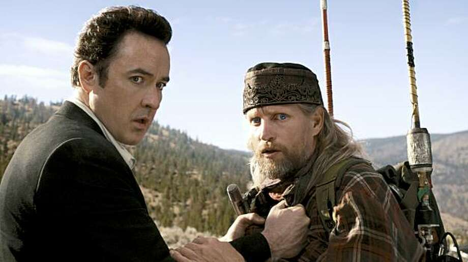 "John Cusack, left, and Woody Harrelson star in Columbia Pictures' ""2012."" The action film will be released November 13, 2009. (Joe Lederer/Columbia TriStar Marketing Group/MCT) Photo: Handout, MCT"