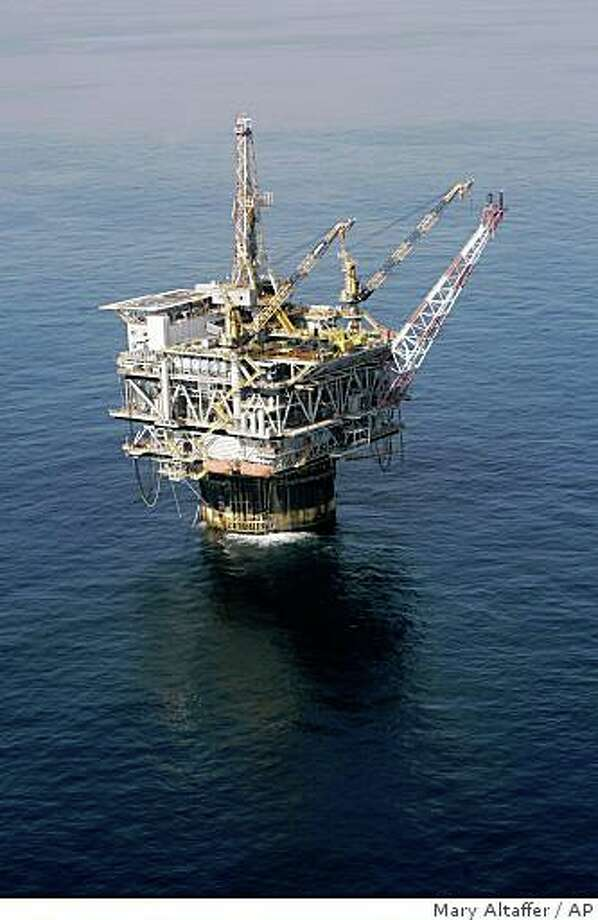 **FILE** In this Aug. 19, 2008 file photo of the Chevron Genesis Oil Rig Platform in the Gulf of Mexico near New Orleans, La. Light, sweet crude rose $2.55 a barrel to $118.82 on the New York Mercantile Exchange Wednesday, Aug. 27, 2008, amid continuing concerns that Tropical Storm Gustav might hit Gulf of Mexico installations. (AP Photo/Mary Altaffer, file) Photo: Mary Altaffer, AP