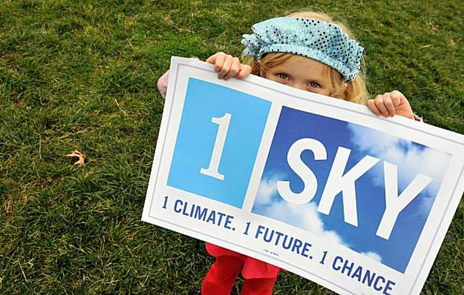 TOPSHOTS Five-year-old Arundhati Baden-Mayer Eidinger holds a sign at a climate change rally outside the White House in Washington on December 4, 2009. Activists are calling for US President Barack Obama to take a strong stand at the December 7-18 climate summit in Copenhagen. TOPSHOTS/AFP PHOTO/ Alex OGLE (Photo credit should read Alex Ogle/AFP/Getty Images) Photo: Alex Ogle, AFP/Getty Images