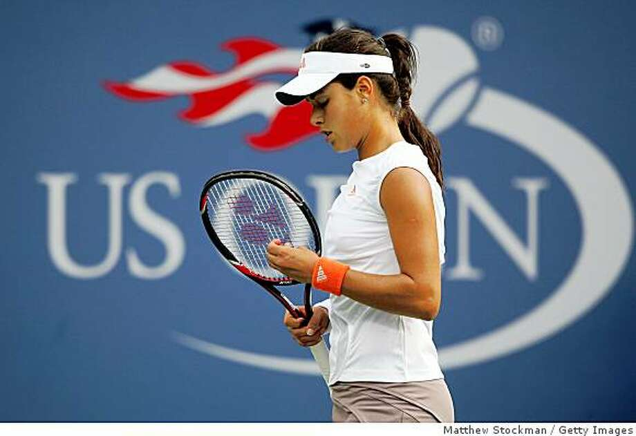 NEW YORK - AUGUST 28:  Ana Ivanovic of Serbia looks  adjusts her racquet against Julie Coin of France during Day 4 of the 2008 U.S. Open at the USTA Billie Jean King National Tennis Center on August 28, 2008 in the Flushing neighborhood of the Queens borough of New York City.  (Photo by Matthew Stockman/Getty Images) Photo: Getty Images