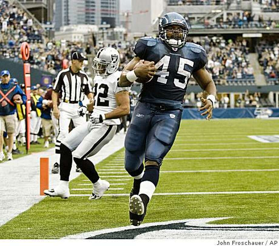 Seattle Seahawks' T.J. Duckett runs into the endzone to score with Oakland Raiders' Nate Lyles running behind the play during the first quarter of an NFL preseason football game Friday, Aug. 29, 2008, in Seattle. (AP Photo/John Froschauer) Photo: John Froschauer, AP