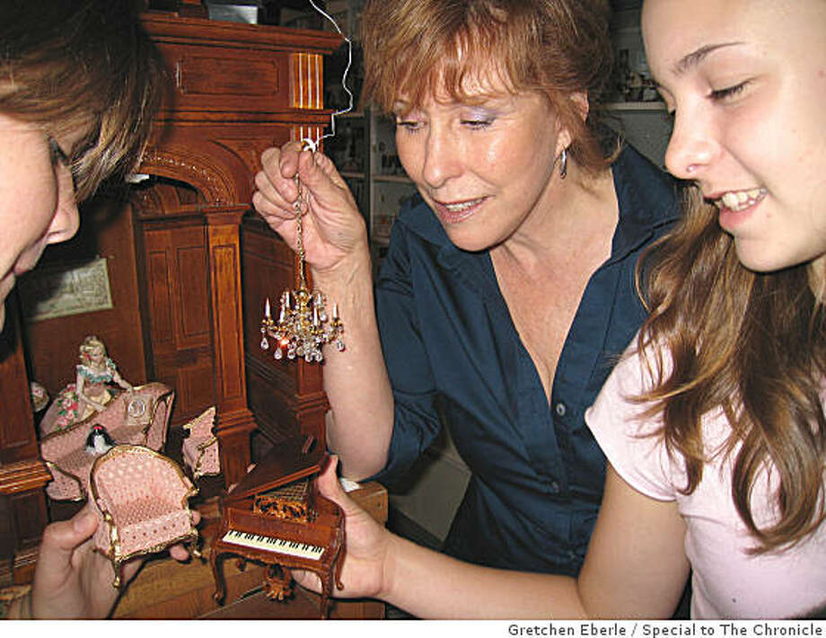 Shellie Kazan, Katie and Paula Eberle: ?Shellie shows Katie and Paula Eberle some Bespaq miniature pieces and a crystal chandelier.? Photo: Gretchen Eberle, Special To The Chronicle
