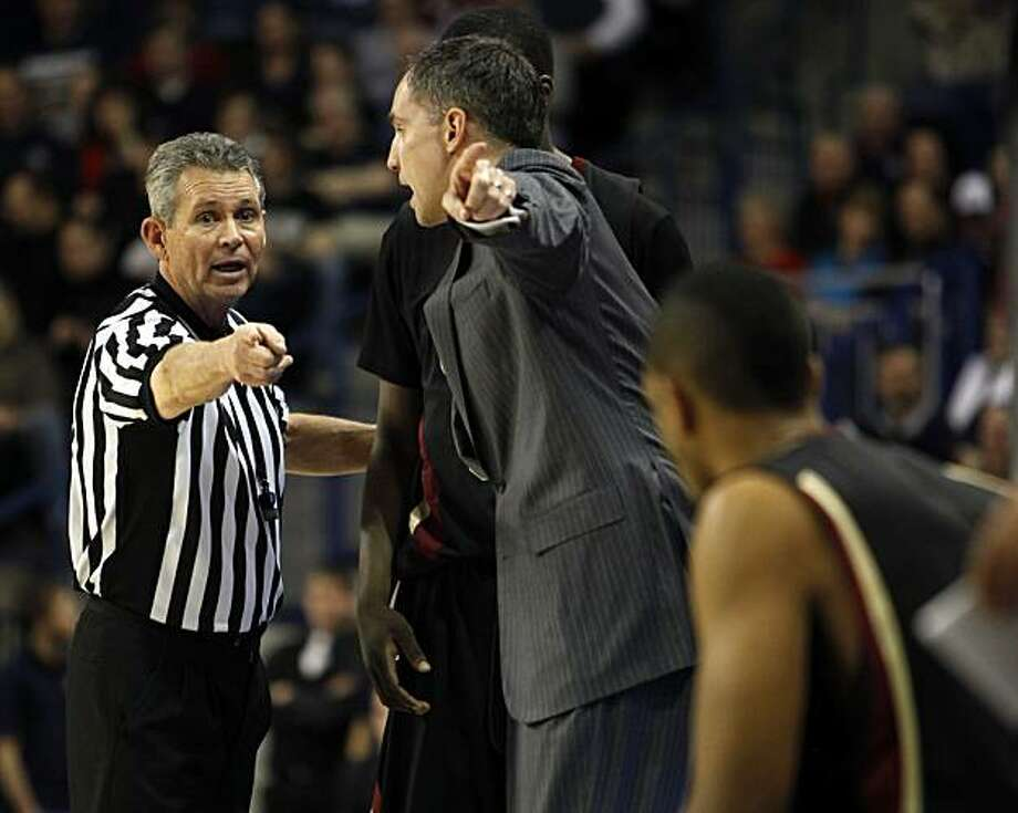 Santa Clara's head coach Kerry Keating argues with official Mark Reischling about a call during the first half of their NCAA college basketball game at the McCarthey Athletic Center in Spokane, WA, Thursday, Feb. 25, 2010. Gonzaga beat Santa Clara 88-51. Photo: Rajah Bose, AP