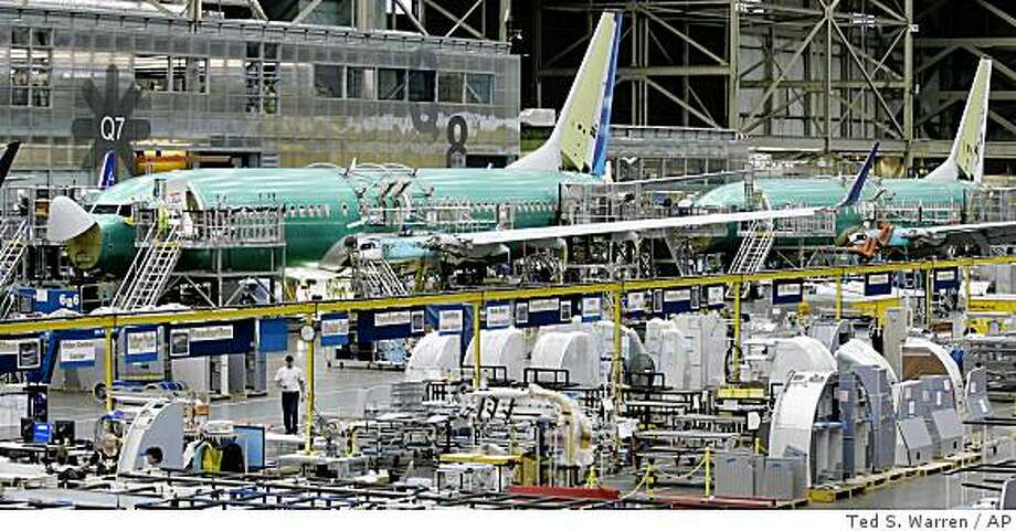 ** FILE ** In this May 20, 2008 file photo, Boeing Co. 737 airplanes are shown lined up during assembly in Renton, Wash. Orders for big-ticket manufactured goods turned in a second consecutive strong monthly performance in July, a far bigger-than-expected gain led by a huge jump in demand for commercial aircraft. (AP Photo/Ted S. Warren, file) Photo: Ted S. Warren, AP