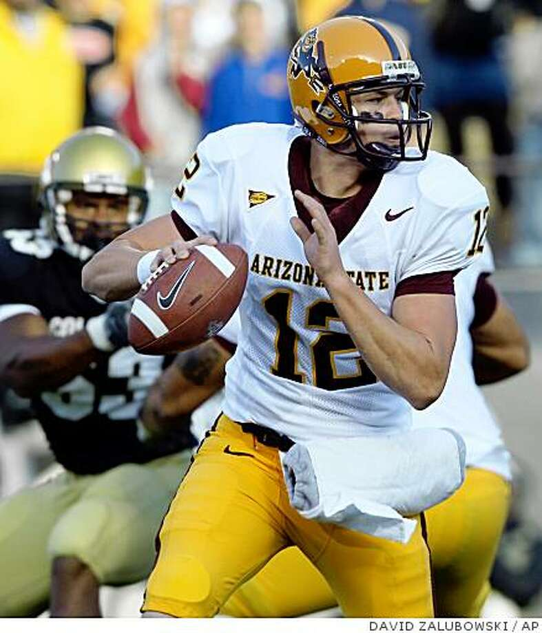Arizona State quarterback Rudy Carpenter, front, scrambles for yardage with Colorado defensive end Abraham Wright in pursuit in the first quarter of a non-conference college football game in Boulder, Colo., on Saturday, Sept. 16, 2006. (AP Photo/David Photo: DAVID ZALUBOWSKI, AP