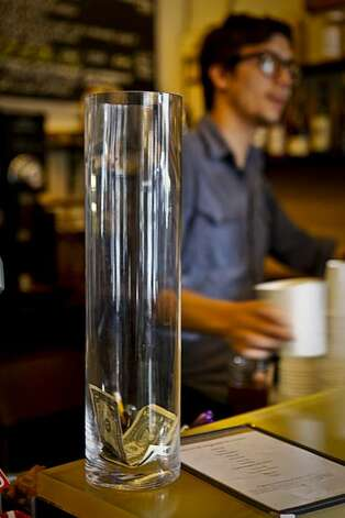 The tip jar at Velo Rouge Cafe in San Francisco, Calif. is seen on Wednesday, Feb. 24, 2010. Photo: Russell Yip, The Chronicle