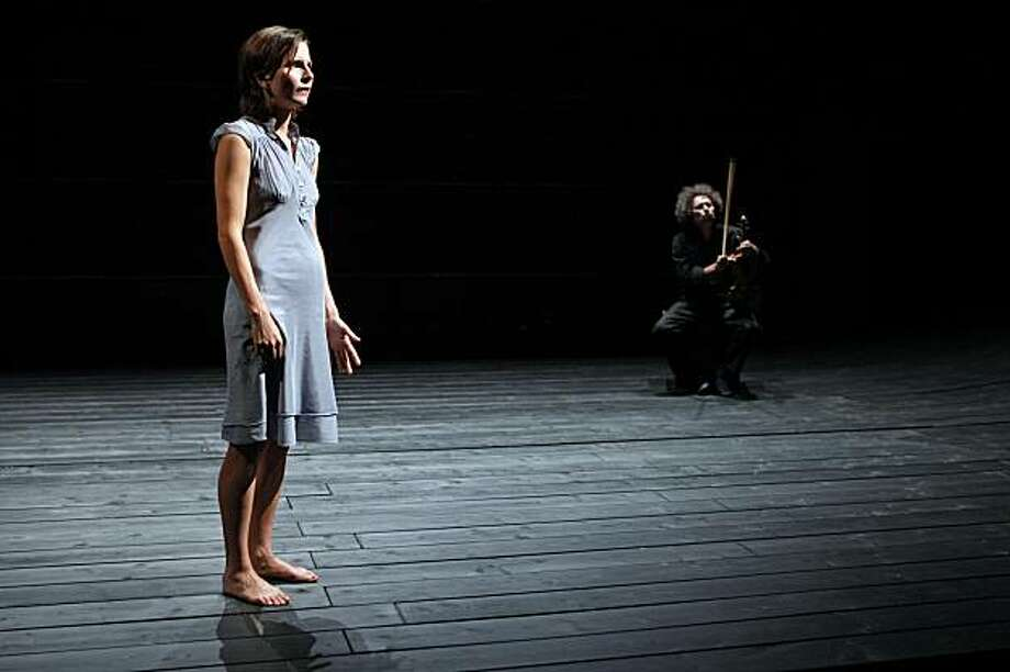 """Astrid Bas and Ami Flammer in a 2008 performance of """"The Lover"""" at the Theatre National de la colline in Paris. Photo: Pascal Victor"""