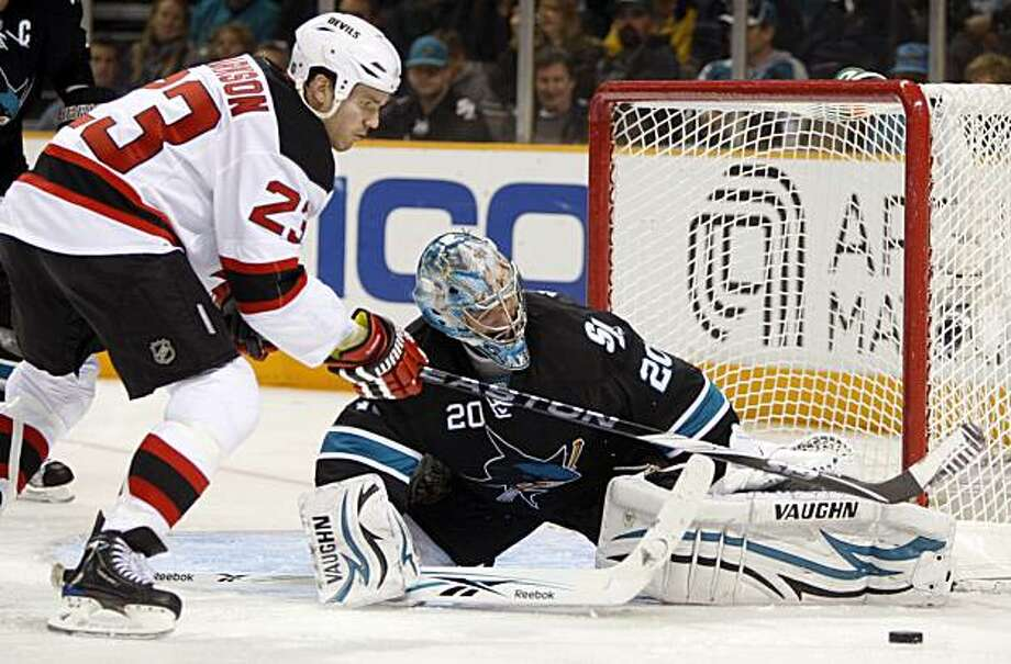 San Jose Sharks' goalie Evgeni Nabokov, right, deflects a shot from New Jersey Devils' David Clarkson during the third period of an NHL hockey game Tuesday, March 2, 2010, in San Jose, Calif. Photo: Ben Margot, AP