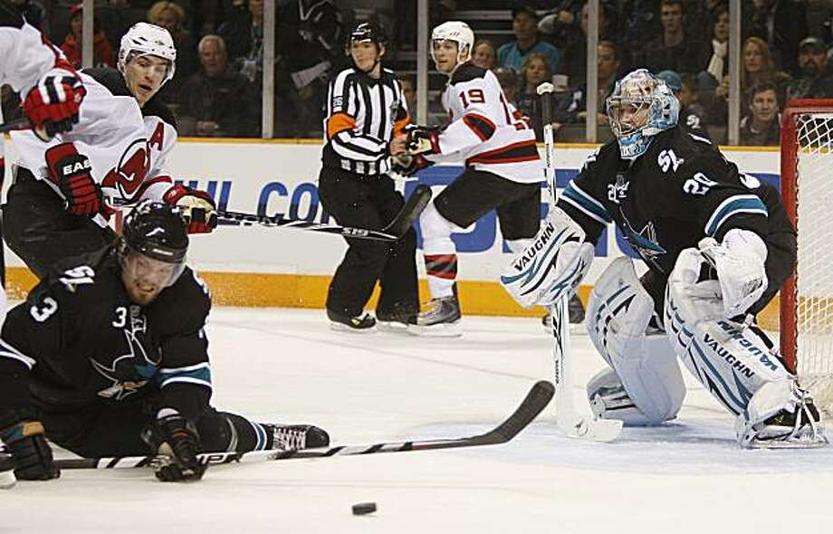 San Jose Sharks' Douglas Murray (3) and goalie Evgeni Nabokov, right, defend against New Jersey Devils'  Zach Parise, top left, during the first period of an NHL hockey game Tuesday, March 2, 2010, in San Jose, Calif. Photo: Ben Margot, AP