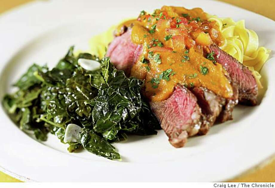 Top sirloin with tomato sauce, egg noodles and sauteed kale in San Francisco, Calif., on August 15, 2008. Food styled by Cindy Lee. Photo: Craig Lee, The Chronicle
