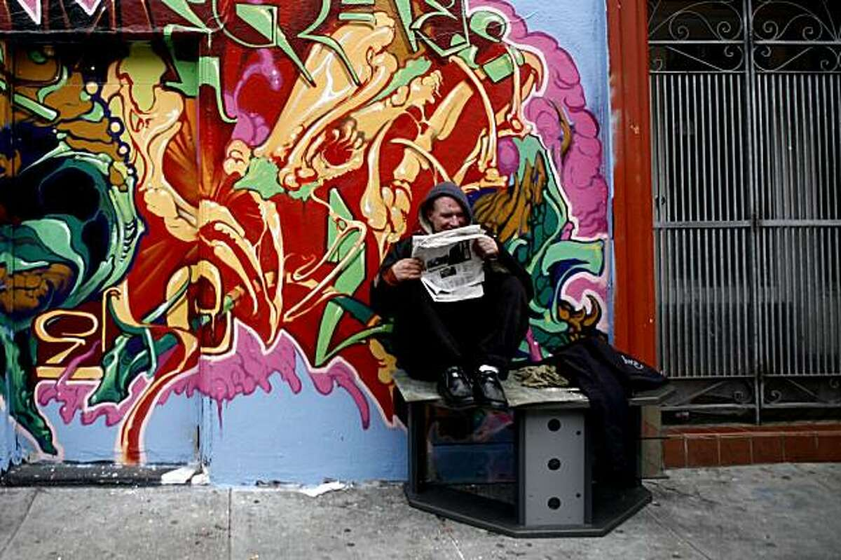 Jeff McChesney reads the newspaper while sitting on a piece of furniture dumped on Cole Street in the Haight District on Monday, Mar 01, 2010 in San Francisco, Calif.