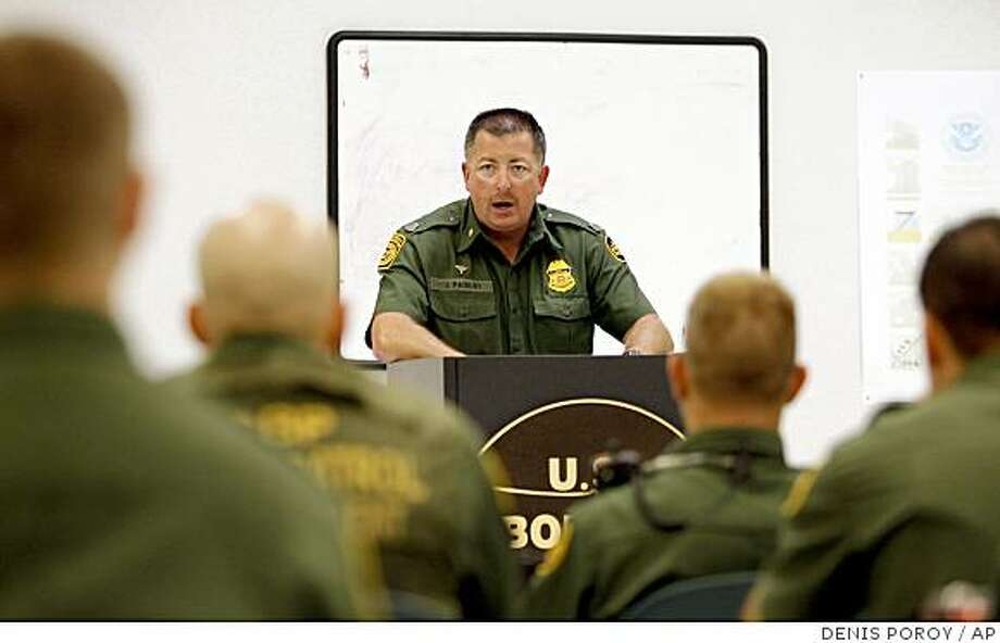 U.S. Border Patrol field operations supervisor John Paisley does the daily briefing for border patrol agents during muster at the Imperial Beach Border Patrol Station Wednesday, Aug. 6, 2008 in Imperial Beach, Calif. The sobering reality of life on the border has created an environment in which about 30 percent of agents leave the agency in less than 18 months. (AP Photo/Denis Poroy) Photo: DENIS POROY, AP
