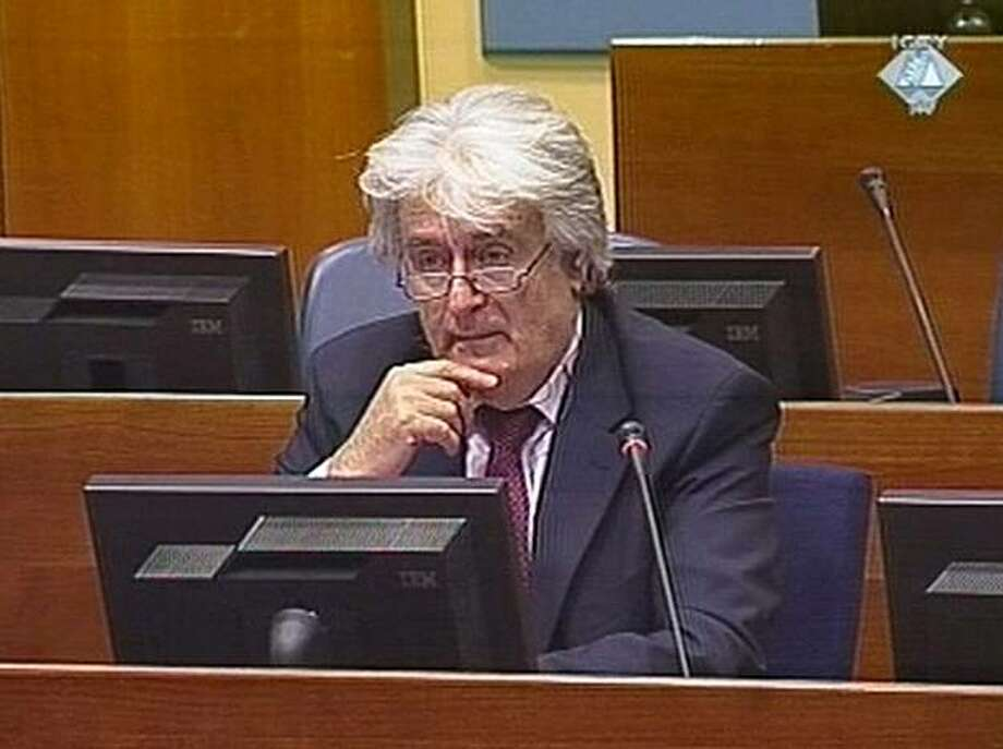 "In this image taken from International Criminal Tribunal for the former Yugoslavia (ICTY) TV camera, showing Former Bosnian Serb leader Radovan Karadzic as he gives his opening statement on Monday, March 1, 2010, at the U.N. war crimes tribunal for the former Yugoslavia.  Karadzic faces charges of genocide and war crimes, accused of orchestrating a campaign to destroy the Muslim and Croat communities in eastern Bosnia to create an ethnically pure Serbian state. Karadzic told the tribunal his cause ""is just and holy"" and that he has a good case against the accusations. Photo: AP"