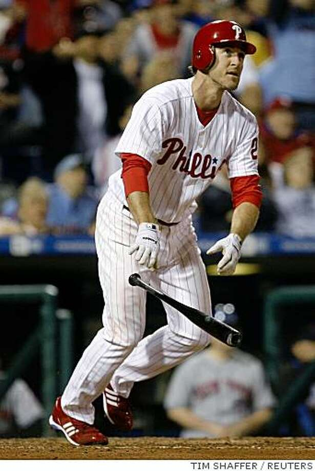 Philadelphia Phillies Chase Utley watches his three-run home run against the New York Mets during the fifth inning of their MLB National League baseball game in Philadelphia, Pennsylvania, April 20, 2008. REUTERS/Tim Shaffer (UNITED STATES) Photo: TIM SHAFFER, REUTERS