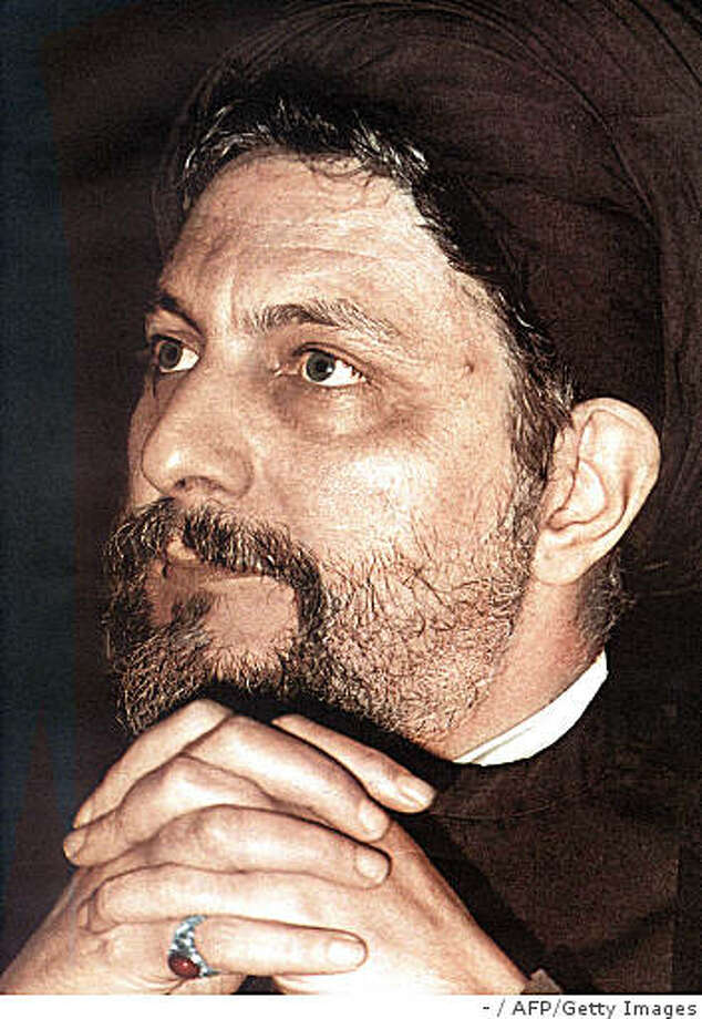 "A combo of file pictures shows Libyan leader Moamer Kadhafi (L) at a press conference in the Libyan capital Tripoli on July 9, 2008 and a reproduction of a photo taken in the 1970s of Lebanese Shiite Muslim religious leader, Imam Mussa al-Sadr, the founder of the Amal movement, which played a major role in Lebanon's civil war between 1975 and 1990. Sadr, who was the head of the Higher Shiite Council in Lebanon, vanished while on a trip to Libya in 1978. Lebanon has issued an arrest warrant for the Libyan leader over Sadr's disappearance, officials in Beirut said on August 27, 2008. Kadhafi was also indicted for allegedly ""inciting the abduction"" of Imam Mussa Sadr, investigating magistrate Samih el-Hajj said in a charge sheet.  AFP PHOTO/DSK (Photo credit should read -/AFP/Getty Images) Photo: -, AFP/Getty Images"