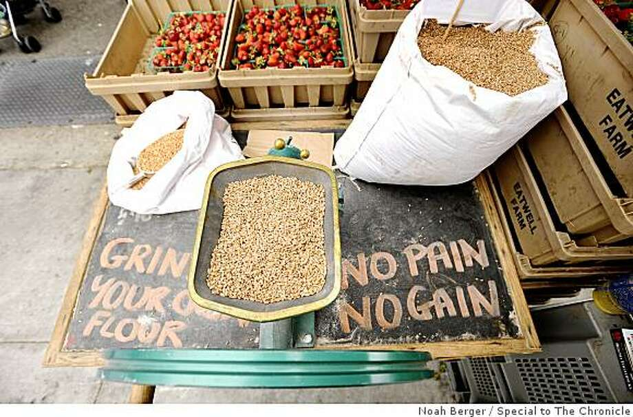 A grinder full of whole wheat berries awaits customers at Eatwell Farm?s stand during the Ferry Plaza Farmers? Market on Saturday, Aug. 23, 2008, in San Francisco. Photo: Noah Berger, Special To The Chronicle