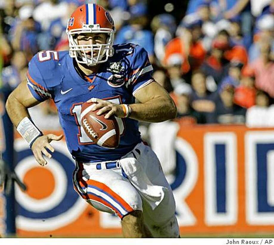 ** FILE ** Florida quarterback Tim Tebow scrambles from the backfield during the second half of a football game against Florida Atlantic in Gainesville, Fla., in this Nov. 17, 2007 file photo. Florida won 59-20. (AP Photo/John Raoux) Photo: John Raoux, AP