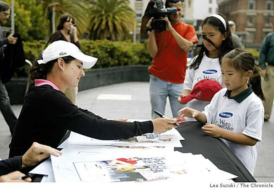Lorena Ochoa (left) signs an autograph for Elisabeth Low,7, (right)  of Granite Bay, CA. at Media Day in Union Square in San Francisco, Calif. on Monday, August 25, 2008. The Media Day was held in advance of the 2008 Samsung World Championship which will be held at Ocean Course in Half Moon Bay, October 1-5 and the Longs Drugs Challenge which will be held at Blackhawk Country Club in Danville October 9-12 . Photo: Lea Suzuki, The Chronicle