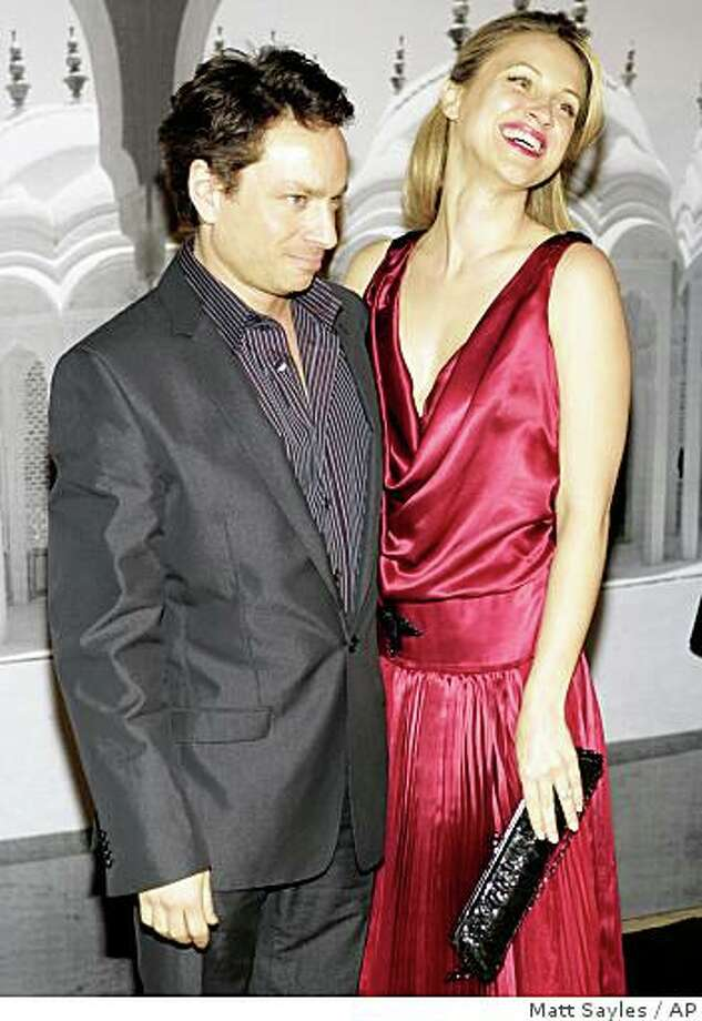 ** FILE ** In this Feb. 24, 2007 file photo, Chris Kattan and model Sunshine Deia Tutt  arrive at the Armani Prive pre-Oscars Fashion Show in Beverly Calif. (AP Photo/Matt Sayles, file) Photo: Matt Sayles, AP