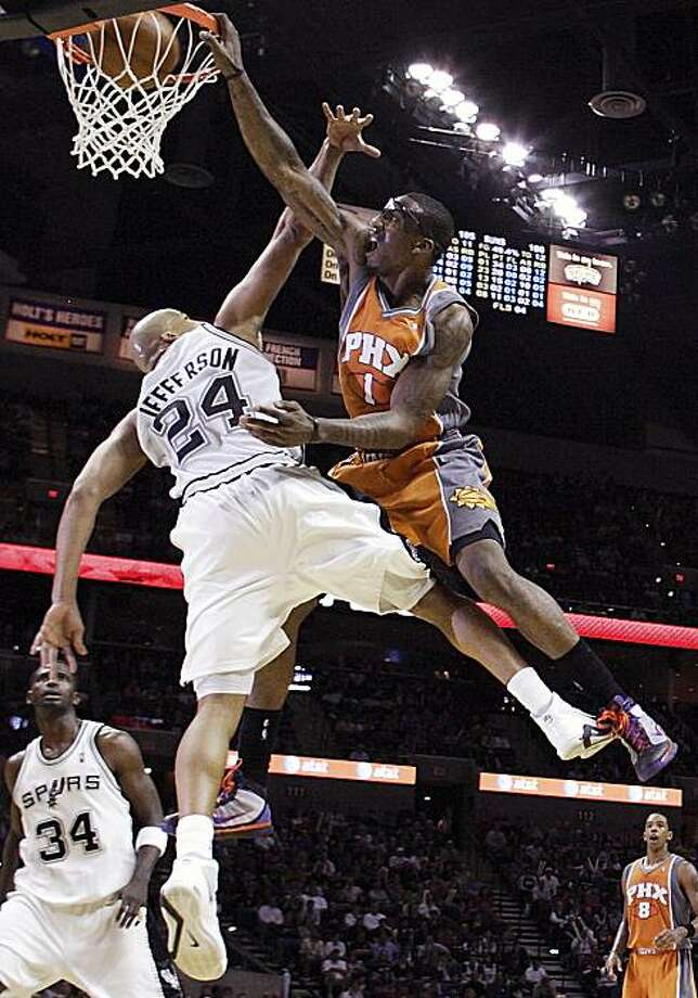 Phoenix Suns' Amare Stoudemire, right, dunks over San Antonio Spurs' Richard Jefferson during the second half of an NBA basketball game in San Antonio, Sunday, Feb. 28, 2010. San Antonio won 113-110. Photo: Darren Abate, AP