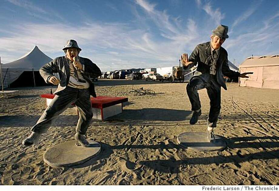 "Two statures of the ""Blues Brothers"" keep theme with the ""American Dream"" on the playa of Burning Man, Black Rock, Nev., on August 26, 2008. Photo: Frederic Larson, The Chronicle"