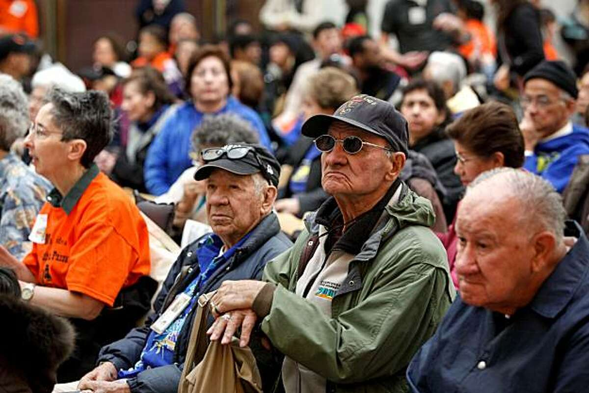 Miguel Rangel, a 46-year Muni rider, listens to public comments during a public meeting of the San Francisco Municipal Transportation Agency in San Francisco on Friday. The agency is facing a $16.9 million budget deficit. Rangel joined about two hundred others in the South Light court of City Hall who were unable to get inside the meeting.
