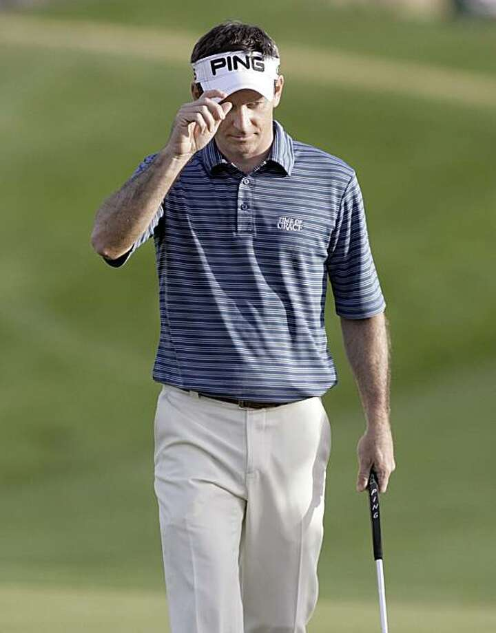 Mark Wilson tips his visor to fans after sinking a birdie putt on the 18th green during the second round of the Phoenix Open PGA golf tournament Friday, Feb. 26, 2010, in Scottsdale, Ariz. Wilson finished the round at 11-under par. Photo: Paul Connors, AP