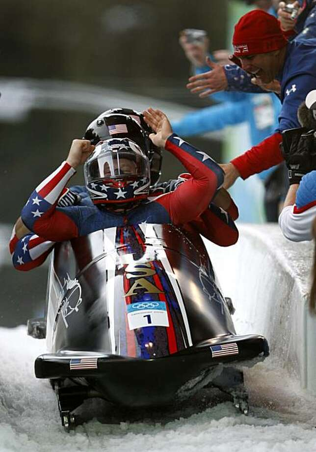 Pilot Steven Holcomb, front, and his USA 1 teammates win the gold medal in the four-man bobsleigh competition at the Winter Olympic Games in Whistler, British Columbia, on Saturday. Photo: Paul Chinn, The Chronicle