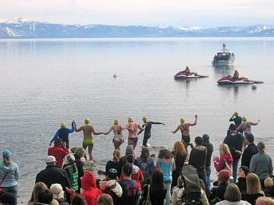 Rescue vessels stand by in the cold waters of Lake Tahoe at Carnelian Bay at last year's Gar Woods Polar Bear Swim during SnowFest. Photo: Mark S. Bacon, Special To The Chronicle